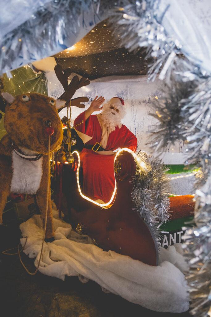 Santa waving in his sleigh at Fowey Christmas Market