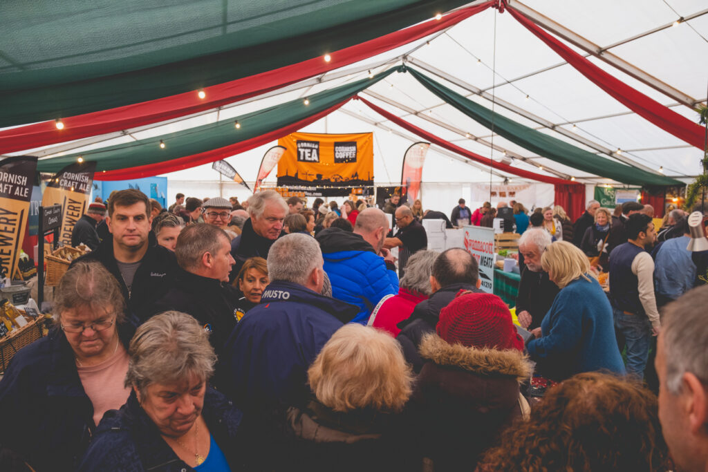 A busy marquee at Fowey Christmas Market